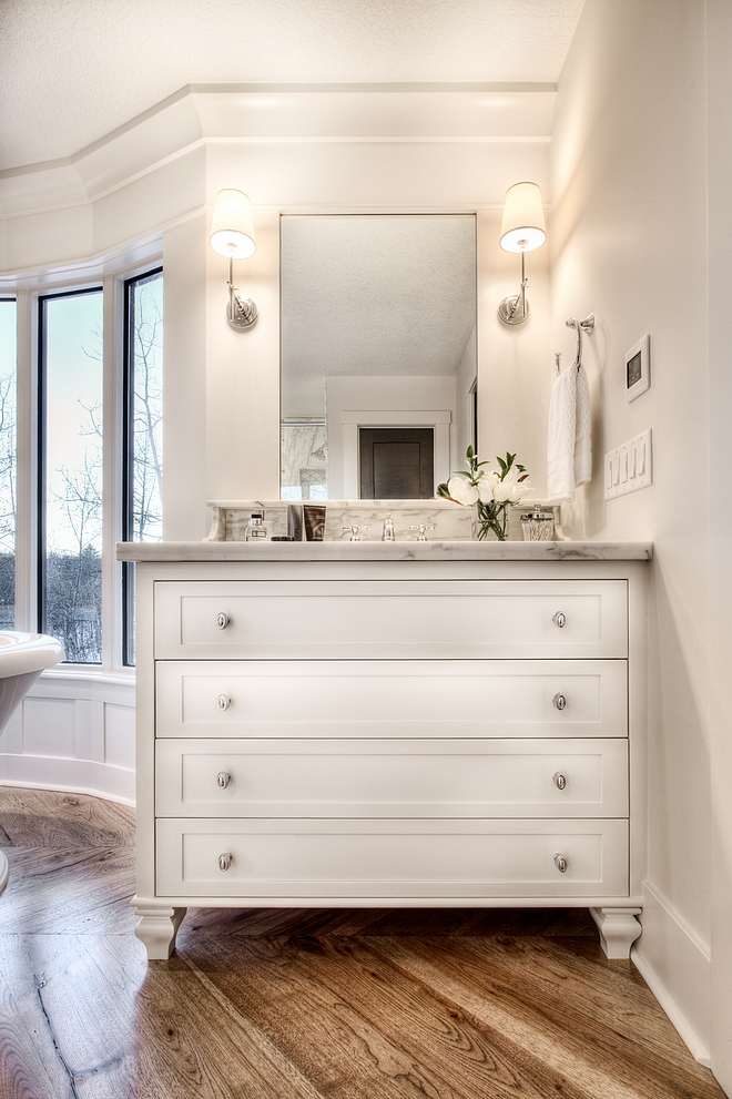 Bathroom vanities are painted in Benjamin Moore Oc-19 Seapearl