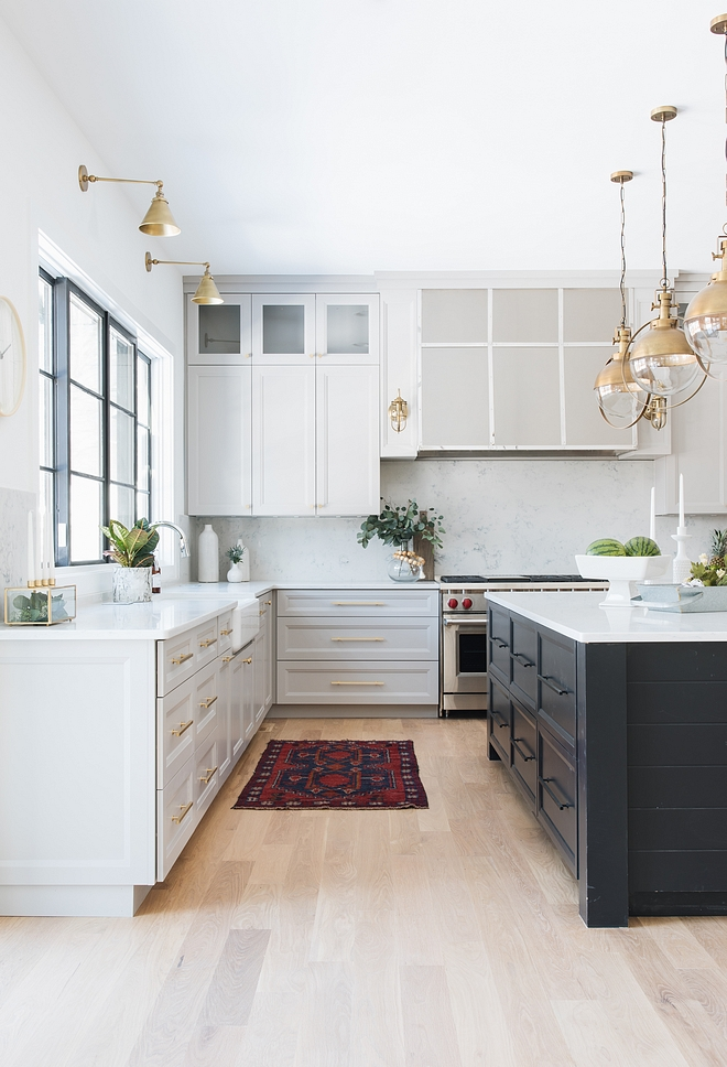 Light Grey Kitchen With Black Island And Bleached Hardwood Floors
