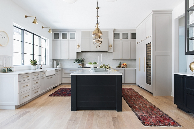 Modern farmhouse kitchen This modern farmhouse kitchen features plenty of cabinetry and large island with shiplap on the sides #modernfarmhouse #kitchen #modernfarmhousekitchen #island #kitchenisland #shiplapkitchenisland