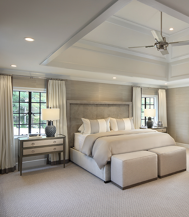 In the master bedroom, the addition of a vaulted ceiling with an applied moulding detail takes this room to the next level The master bedroom now feels much more grand and open A neutral color palette with contrasting colors of grey and black keep this room serene yet sophisticated