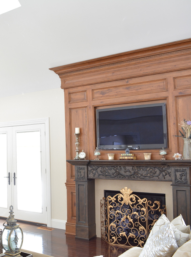 Traditional Fireplace Millwork featuring two-toned wood and detailed hand carvings