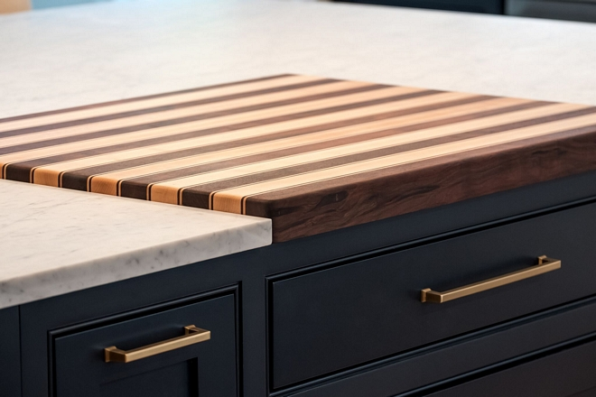 The butcher block cutting board was custom built by a local cabinet maker specifically for this home The cutting board features Walnut and Mable inlay - more details on Home Bunch