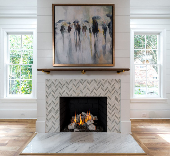 "Carrera marble hearth Custom tile surround 42"" Isokern vent free natural gas fireplace Shiplap accent wall Sleek Mantel Ideas"