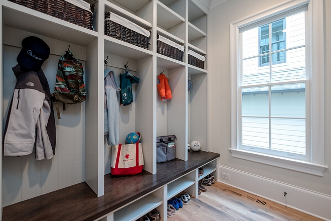 Mudroom A large home needs lots of storage and there is nothing better than a custom drop zone space with plenty of room for all your coats and shoes #mudroom