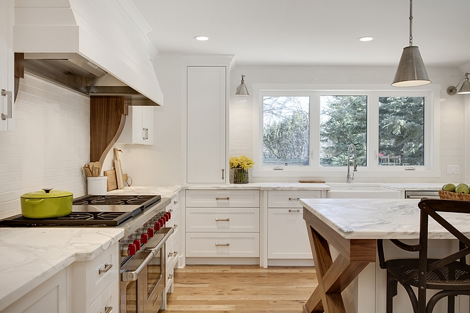 White Kitchen with Walnut accents on corbels and on island