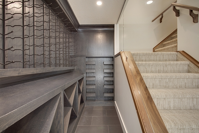 Long Wine Room with Dark Stained White Oak Cabinetry Basement Wine Room Wine Room Basement wine room Ideas #WineRoom