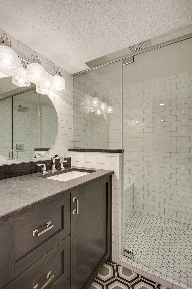 Basement Bathroom This basement bathroom has plenty of personality I especially like the shower with built-in bench and the affordable, yet timeless, tile choices Cabinet is Oak with black stain Basement Bathroom #Basement #Bathroom