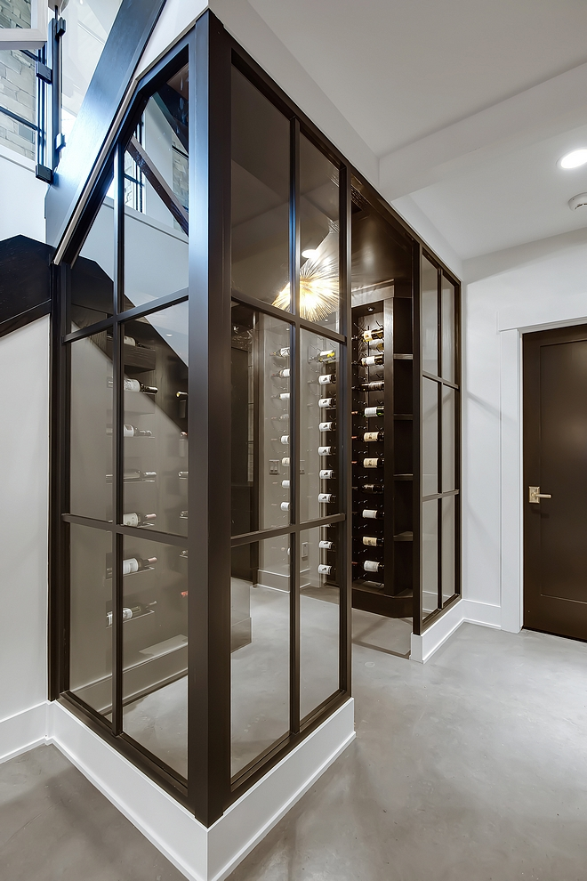 Wine Enclosure Wood and glass walls with glass door leads to the wine room #wineroom