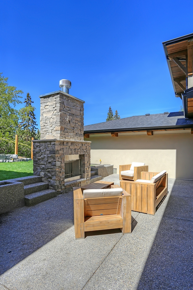 Outdoor wood burning fireplace This large exposed aggregate patio features a wood burning fireplace with natural stone surround Stone Sill Buff Limestone with pitched edges Outdoor wood burning fireplace #Outdoorwoodburningfireplace