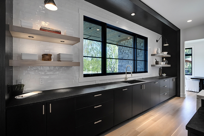 Kitchen Sink Cabinetry Kitchen Sink Cabinetry The kitchen sink wall features built-on-site 1⁄4 Sawn Oak kitchen cabinetry with extensive drawer detailing, pull out trash cans and cabinets to the ceiling #KitchenSinkCabinetry #SinkCabinetry