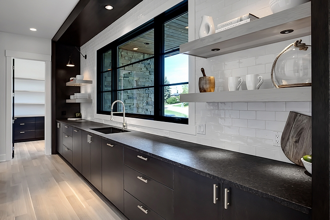 Kitchen sink wall Kitchen sink wall with lower cabinets floating shelves and large black windows Kitchen sink wall #Kitchen #sinkwall