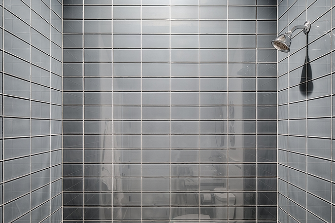 Grey glass tile in a bathroom shower. #bathroomdesign #glasstile #Showertile #greyglasstile