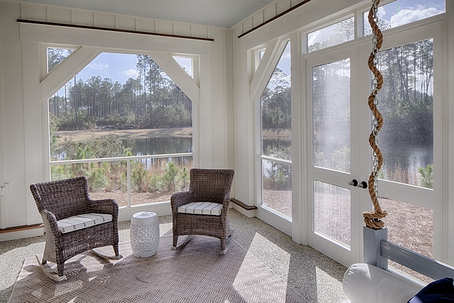 Screened porch with rocking wicker chairs and swing bed great way to create comfort in a small screened porch #screenedporch #smallscreenedporch