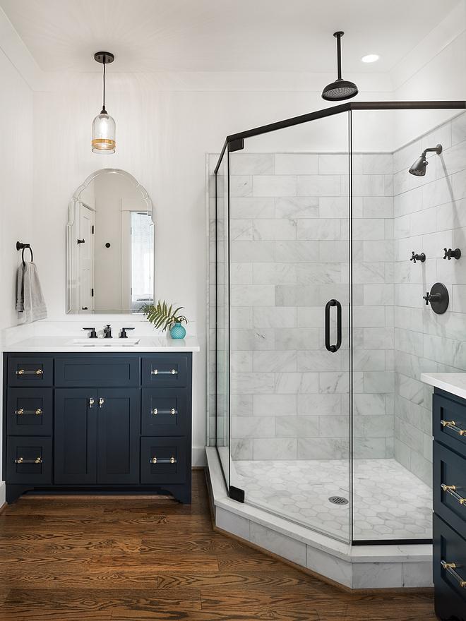 Farmhouse bathroom Farmhouse bathroom with black framed shower blue cabinets and hardwood flooring Farmhouse bathroom #Farmhousebathroom #bathroom #bluecabinet #bathroomhardwoodflooring #blackshower