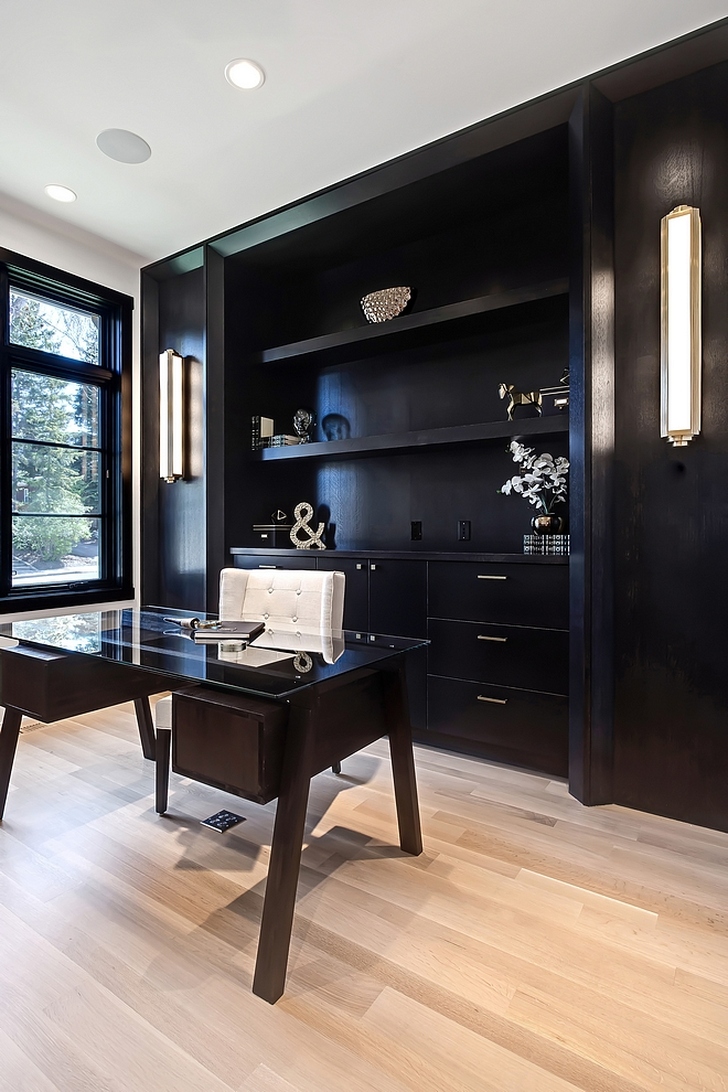 Home Office Black Cabinetry Home Office Ebony stained built in cabinets look great with black steel windows and light hardwood flooring #homeoffice #ebonycabinetry #blackwindows #lighthardwoodflooring