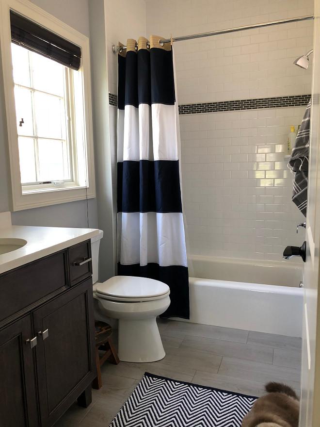 Boys Bathroom Neutral Boys Bathroom You cannot go wrong with subway tile and the floor is a subtle textured rectangular tile Boys Bathroom #Boysbathroom