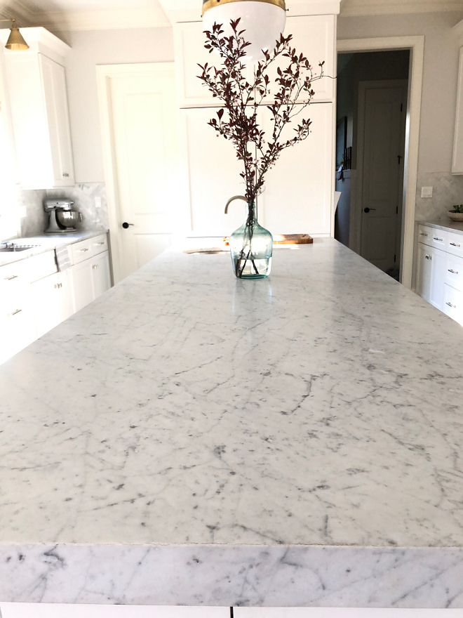 Countertop Carrara marble counters and other side of island HONED MARBLE, 3 inch mitered wedge Countertop is Honed Carrara marble - Side of islands have 3 inch mitered wedge #countertop