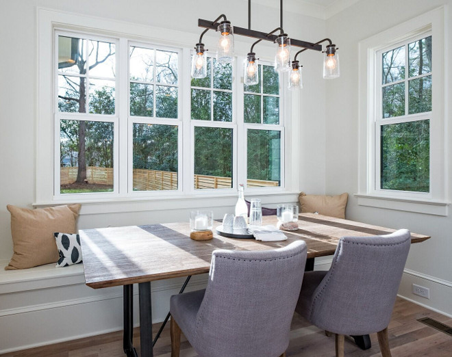 Farmhouse Breakfast Nook with industrial linear chandelier and built-in banquette #farmhousebreakfastnook #breakfastnook #banquette #farmhouselighting #industriallinearchandelier