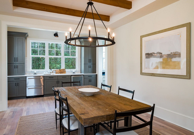 Farmhouse Dining Room with Grey Butler's Pantry Beautiful Farmhouse Dining Room with ceiling beams, hardwood flooring and Grey Butler's Pantry #FarmhouseDiningRoom #GreyButlersPantry