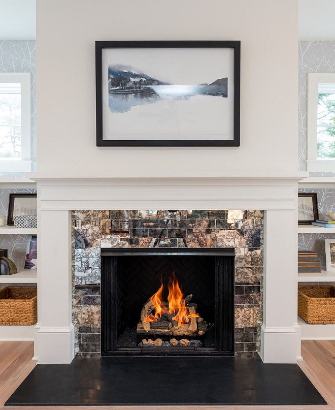 Fireplace features antique subway tile and leathered black granite