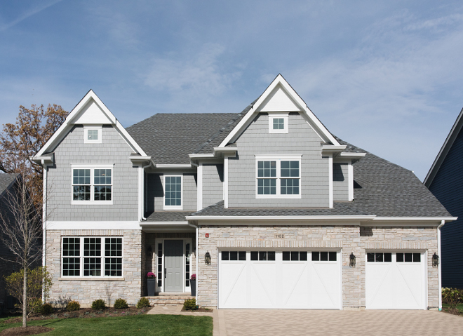 Siding and shakes are Hardie Grey Slate We color matched the front door to the Grey Slate Trim is Hardie Arctic White The stone is Blue River Select Gray The brick is Aztec White and the shingles are Aged Pewter #siding #greysiding