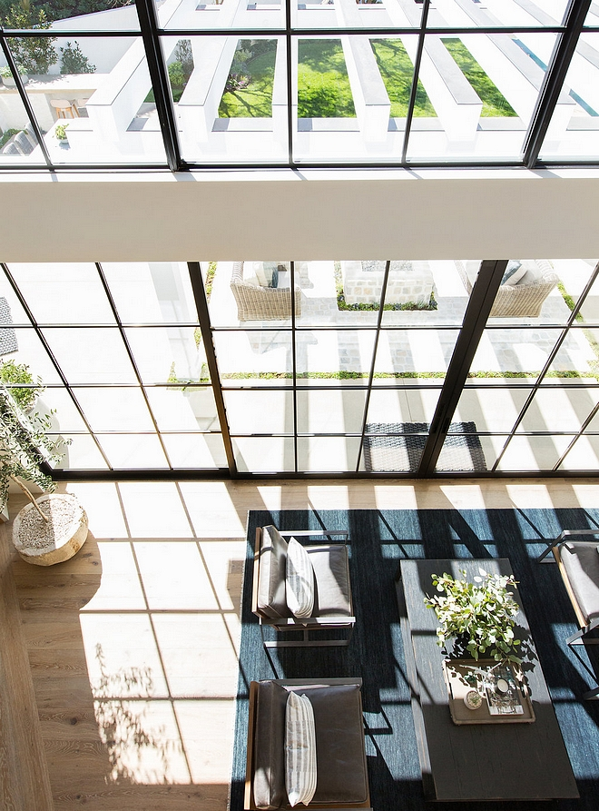 Floor to ceiling Black Windows and Black Steel Patio Door allows plenty of natural light in Floor to ceiling Black Windows Floor to ceiling Black Windows #FloortoceilingBlackWindows #BlackWindows