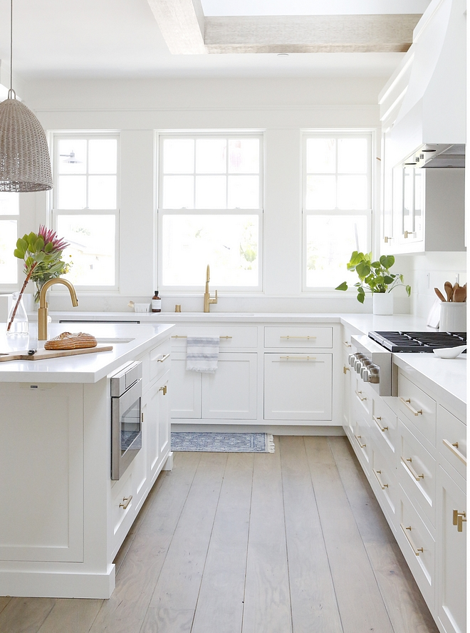 White Kitchen Cabinet The cabinetry was custom built as framed inset and painted Simply White by Benjamin Moore #whitekitchen #whitekitchencabinet #kitchencabinet #kitchencabinetry