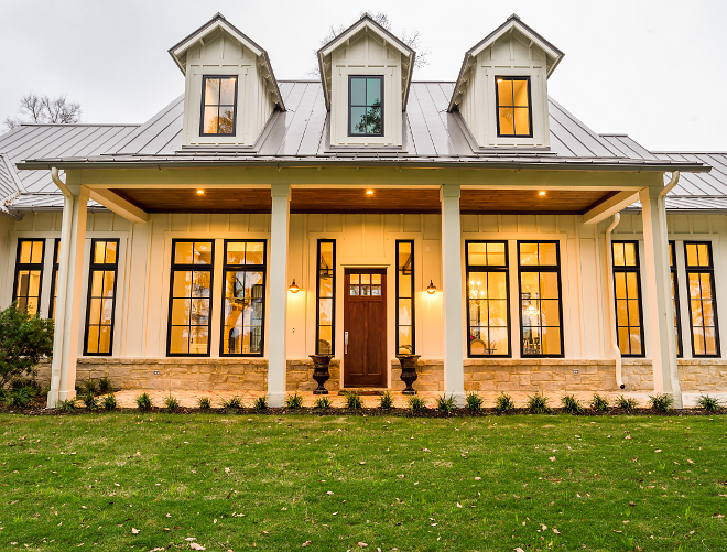 Modern Farmhouse Front Porch Metal Roof The front porch of this farmhouse features black windows, metal roof and a welcoming wooden front door Modern Farmhouse Front Porch Metal Roof #ModernFarmhouse #FrontPorch #MetalRoof