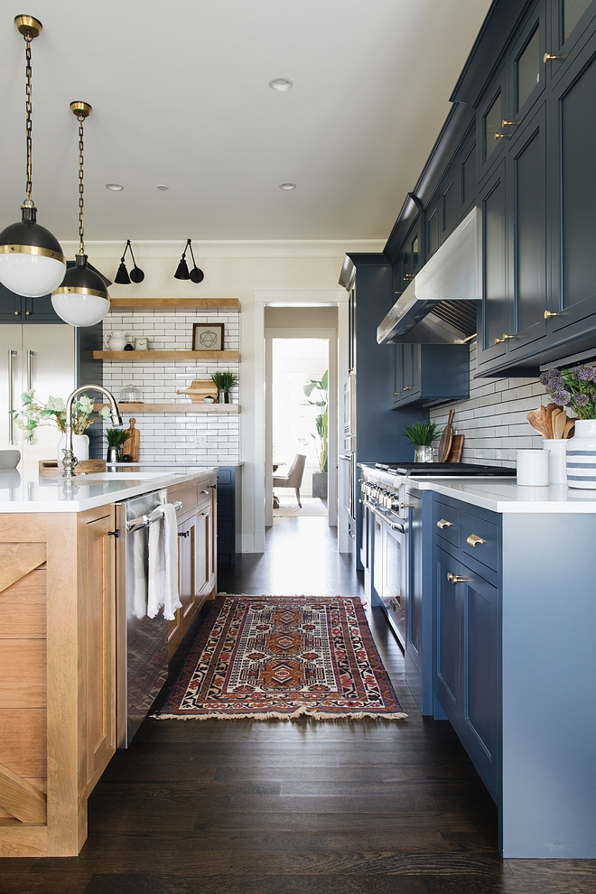 Navy kitchen with antique runner Beautiful Dark Navy kitchen with antique runner source on Home Bunch Navy kitchen with antique runner #Navykitchen #antiquerunner #kitchenrunner