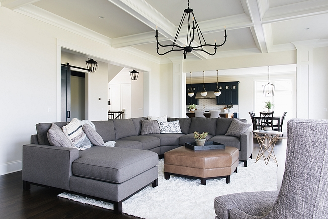 This living room is about 30x17' with 10' ceilings To bring detail and coziness to the large space the designer designed a coffered ceiling and a fireplace mantel that drew your eye up to the ceiling detail