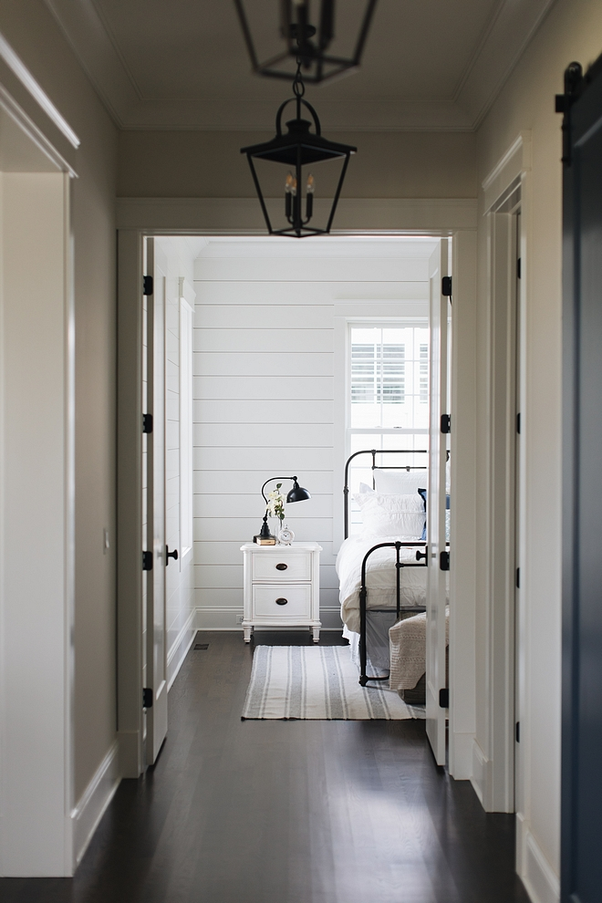 Benjamin Moore Simply White Shiplap Paneling Paint Color with Simply White Trim and Dark Hardwood Flooring #BenjaminMooreSimplyWhite #Shiplap #Paneling #PaintColors