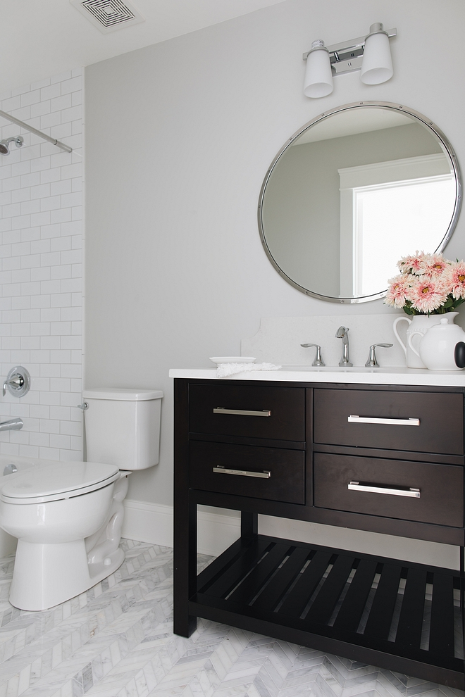 "This bathroom is a perfect combination of masculine and feminine with a dark wood cabinet from RH next to a Chevron Carrara marble floor Countertop Misty Carrera Honed Backsplash is 8"" tall with scallop edge"