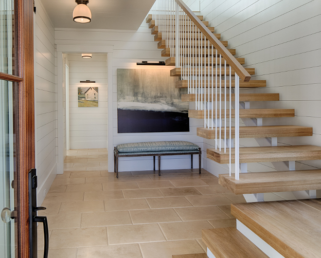 White Oak Floating Staircase with shiplap paneling The foyer features shiplap, honed and pillowed Travertine floor tile and floating stairs with thick White Oak treads #foyer #shiplap #floatingstaircase #whiteoakstaircase