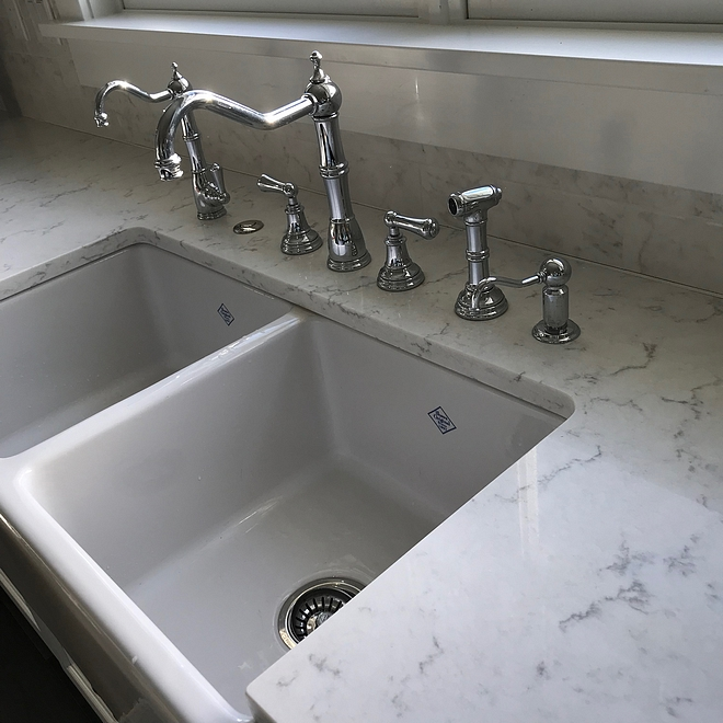 Kitchen faucets The plumbing fixtures from left to right are a Perrin & Rowe Traditional Filter Faucet in polished chrome, air activated switch button for the garbage disposal, Perrin & Rowe 4-Hole Kitchen Faucet With Sidespray, and Perrin and Rowe Soap/Lotion Dispenser #kitchenfaucet #kitchenfaucets #kitchen #faucet