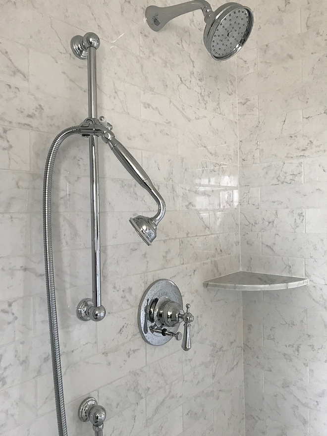 The shower features a Perrin & Rowe Georgian Era Pressure Balance Trim Kit with a diverter and a wall mounted shower arm on a sliding rail A Rohl 5 inch Bordano showerhead completes the look