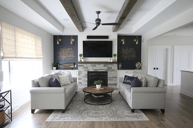 Farmhouse Living Room In the Living Room, there are many details that I adore, but one of my most favorite is the navy shiplap on either side of the fireplace. It was definitely a bold decision, but one that we absolutely LOVE! Farmhouse Living Room #Farmhouse #FarmhouseLivingRoom #LivingRoom