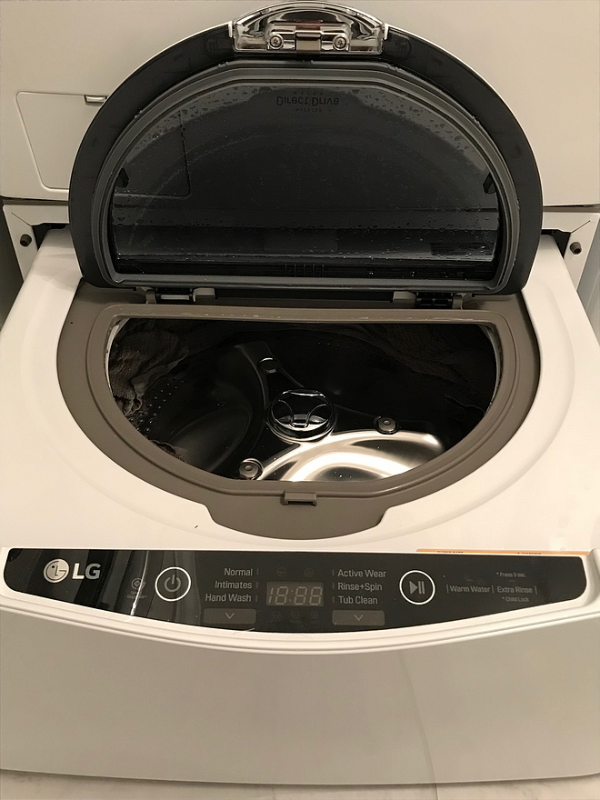 Laundry Room pedestal SideKick washer Efficiency is critical with our family of six We choose the LG Sidekick instead of a traditional pedestal for our washing machine so that we could do two different loads of laundry at the same time pedestal SideKick #washer #dryer #pedestal #SideKick #washer #LG #laundryroom