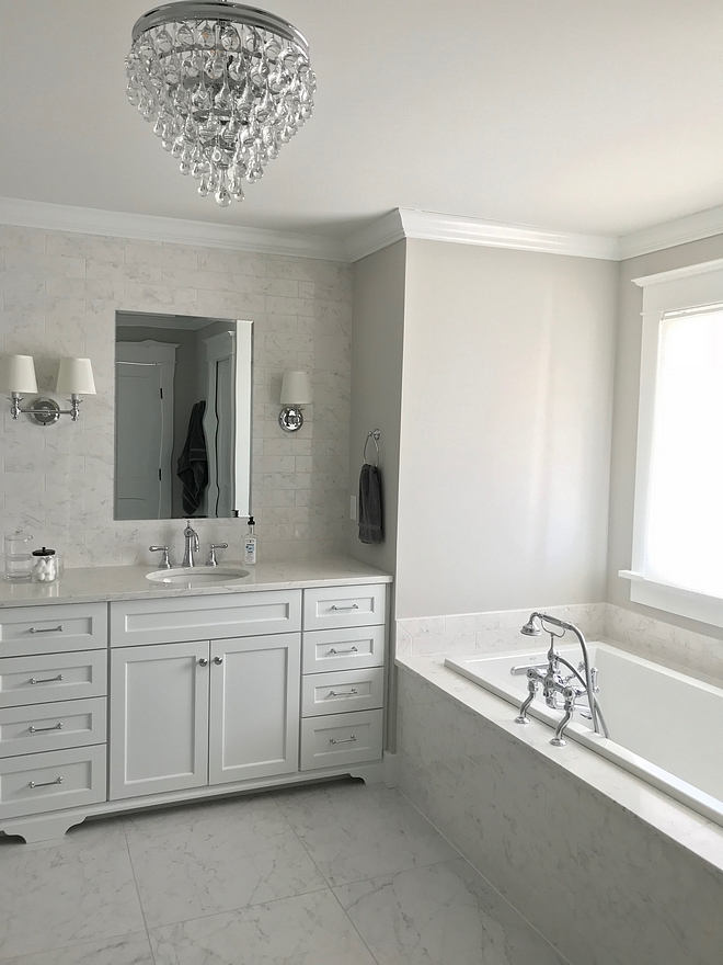 White Marble Bathroom Tile The floor tiles are Eon Carrara 24 inch rectified floor tiles from Atlas Concorde with Rolling Fog grout White Marble Bathroom Tile #WhiteMarble #Bathroom #Tile