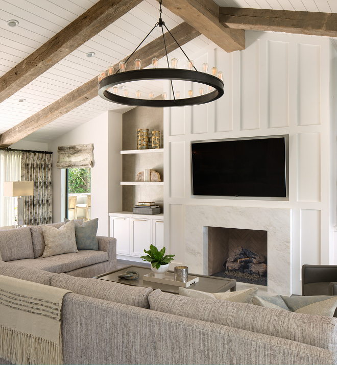 Living room paneling thick board and batten on fireplace with vaulted ceiling featuring reclaimed beams Board and batten fireplace vaulted ceiling fireplace Board and batten fireplace vaulted ceiling fireplace Board and batten fireplace vaulted ceiling fireplace #Boardandbattenfireplace #vaultedceiling #fireplace