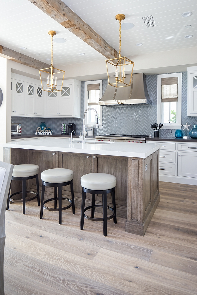 Farmhouse kitchen with exposed reclaimed beams wide plank hardwood flooring White Oak kitchen island and herringbone backsplash Kitchen farmhouse kitchen kitchens #Farmhousekitchen #kitchen #exposedbeams #reclaimedbeams #wideplankhardwoodflooring #hardwoodflooring White Oak kitchen island and herringbone backsplash