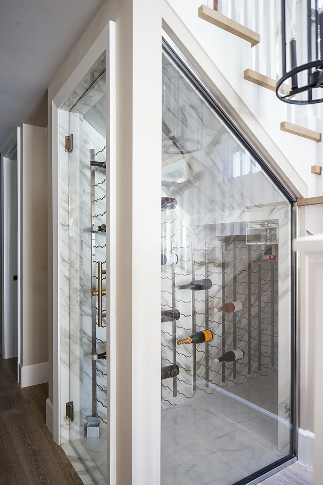 Under stair wine cellar The under stair wine cellar features stone slab walls, vintage-style wine racks and custom glass enclosure and door Understair wine cellar Understair wine cellar Understair wine cellar #Understairwinecellar #winecellar