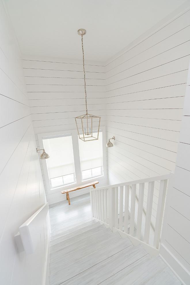 Sherwin Williams SW 7005 Pure White Shiplap and stair threads paint color Sherwin Williams SW 7005 Pure White Sherwin Williams SW 7005 Pure White #SherwinWilliamsSW7005PureWhite