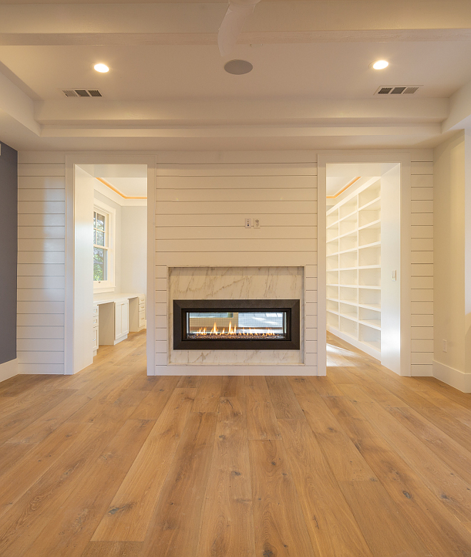 Shiplap Fireplace Two sided shiplap fireplace in master bedroom separating the main area to the bedroom sitting area Fireplace stone is Calacatta Cremo marble Shiplap Fireplace Shiplap Fireplace #ShiplapFireplace