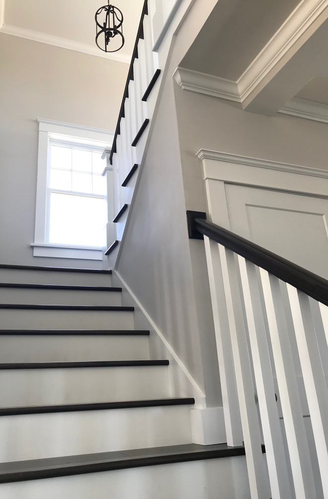 The railing is custom stained to match the walnut stair treads We chose to use open stairs to highlight the exposed walnut treads We also love the contrast of the white woodwork against the dark wood flooring #railing #stair #staircase #walnutstairtreads #stairtreads