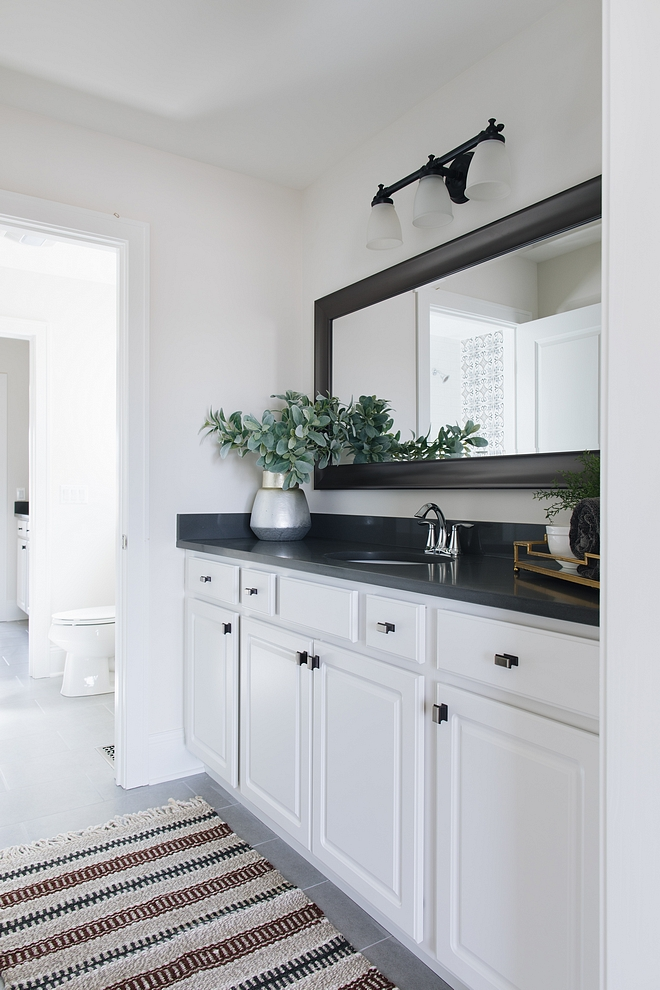 Bathroom Keeping the cabinets white keeps with the classic look and will appeal to most buyers Countertop is a dark grey quartz #bathroom