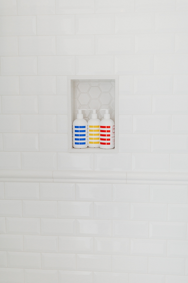 Shower 3x6 beveled white subway tile The walls have beveled high gloss 3 x 6 arctic white subway tile with white grout, capped in a chair rail beveled white subway tile #beveledwhitesubwaytile