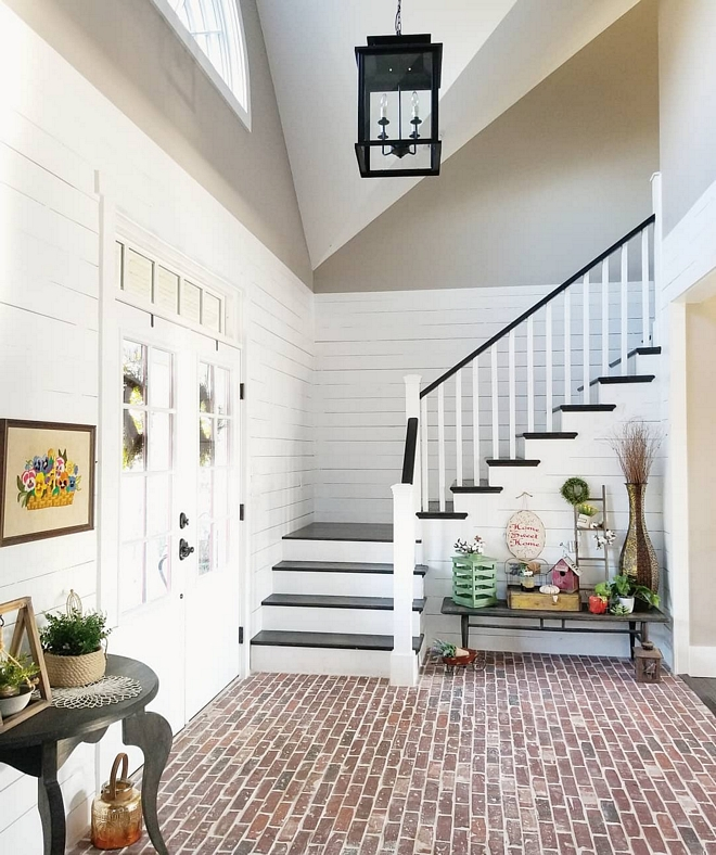 Shiplap wall with brick flooring We added real shiplap and painted it in Sherwin Williams Extra White in the two story foyer as well to give the brick a softer contrast Foyer Shiplap wall with brick flooring #Shiplap #brickflooring