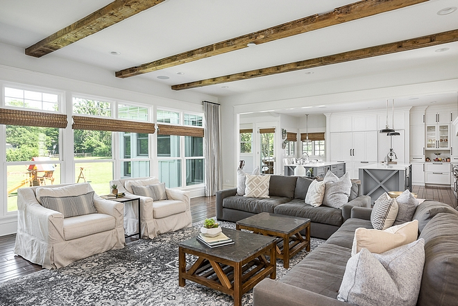 Reclaimed Wood beams in Living room with windows with natural Roman shades to keep the same organic natural feel Reclaimed Wood beams #ReclaimedWoodbeams #Reclaimedbeams