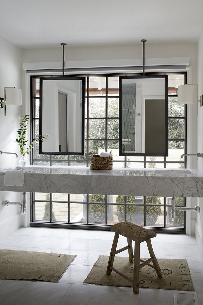 Floating Marble Vanity Bathroom Floating Marble Vanity Floating Marble Vanity Ideas floating marble vanity in front of a full-height wall to wall window ceiling-mounted iron mirrors Floating Marble Vanity #FloatingMarbleVanity #FloatingVanity #FloatingVanity