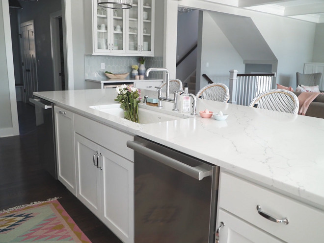 Kitchen Faucet Kitchen island The kitchen island features a sink, a modern faucet, two dishwashers and a marble-looking quartz countertop Vicostone Venatino white quartz countertop Kitchen Faucet Kitchen Faucet #KitchenFaucet